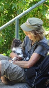 Donna carries a weight in her backpack to help her bad back.  That weight is her cat, Stoney.
